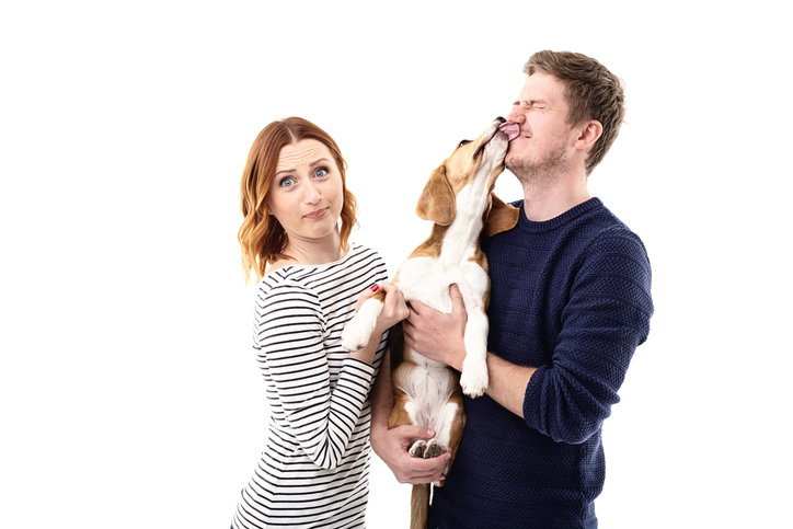 Pet licking owner's face