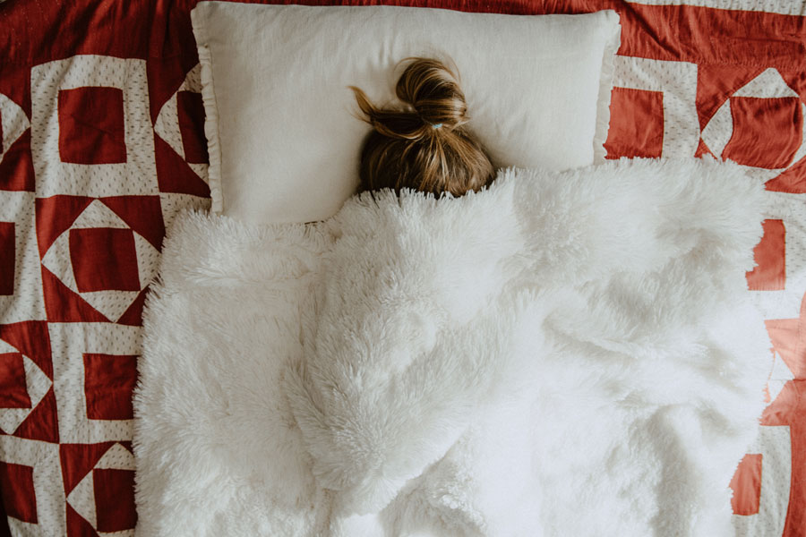 woman under bed covers