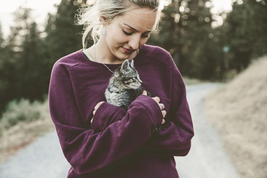 woman holding kitten, pet owner